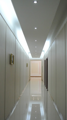 """""""Long, empty hallways. My father's reaction to staying in a bugged luxury socialist guesthouse was to simply leave his door open."""""""