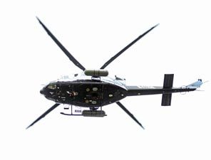 A low flying helicopter taking baseline radiation survey