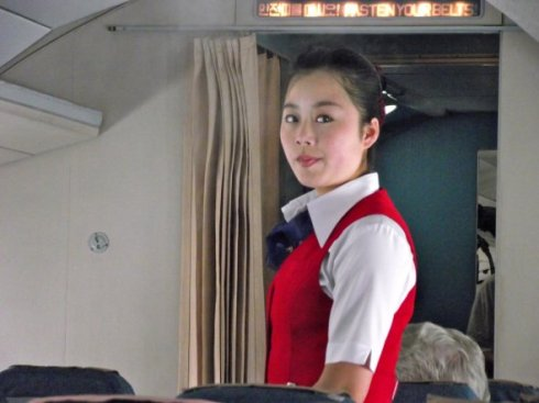 Reviewers nearly unanimously say that the flight attendants are friendly and efficient, but perfunctory. They earned a 3 star rating for Grooming and Presentation