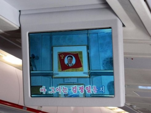 Flipdown TV screens with homages to Kim (Sr) (Jr) )3rd) for passenger entertainment