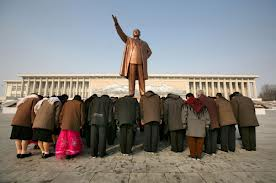 Tourists Bow Paying Homage to Kim Il Sung
