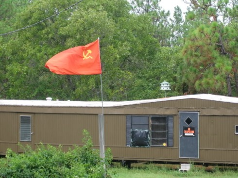 The hammer and sickle fly over rural South Carolina white racist group's headquarters