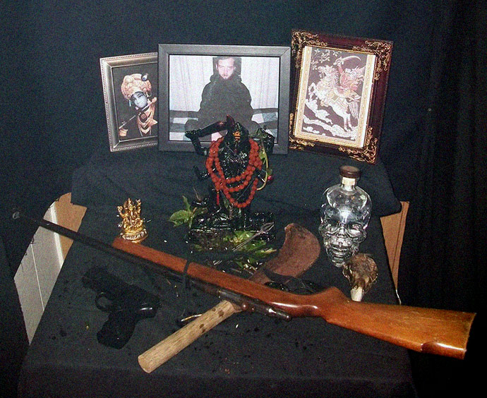 "Photo of weapons and other offering to the Hindu Goddess kali at Joshua Sutters rural South Carolina property. Titled ""Their Lordships Shree Shree Kalki-Kalaratri , New Bihar Mandir, United States"", the photo is taken from the official New Bihar mandir temple website and posted in 2009"