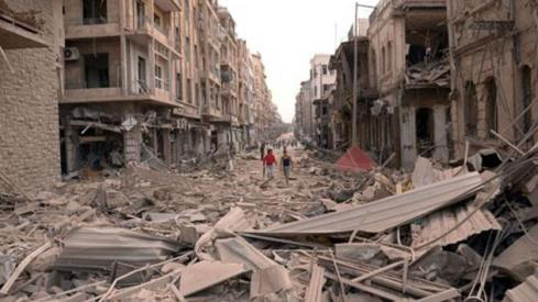 photo released by the Syrian official news agency SANA, Syrians walk through the rubble at the scene where multiple explosions hit the center of Aleppo, Syria on October 3, 2012.  Read more: http://www.upi.com/Top_News/Special/2012/12/13/Scud-attacks-signal-Syrian-regime-alarm/UPI-97451355420939/#ixzz2X0Vgz6Ru