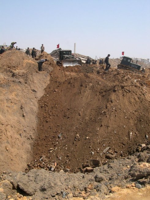 Photo of crater after explosion, Ryongchon 2004 | Picture credit: David Hill, ECHO