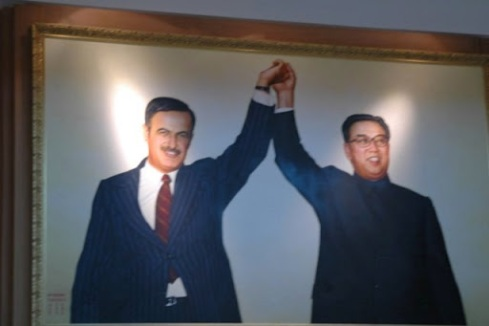 Large portrait of founders of Syria and North Korea at the North Korean constructed and designed Tirshan War memorial museum in Damascus