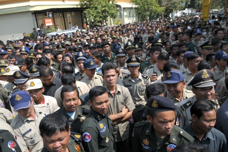 "Hundreds of police, military police wait outside the Phnom Penh mansion of Choeung Sopheap, the owner of Pheapimex company and wife of CPP Senator Lao Meng Khin, to receive envelopes of money for the Chinese New Year. (Ben Woods/The Cambodia Daily) All were waiting for their promised ""ang pao""—red envelopes containing cash usually handed out during Chinese New Year—from Choeung Sopheap, the powerful owner of controversial land development firm Pheapimex and the wife of CPP Senator Lao Meng Khin."